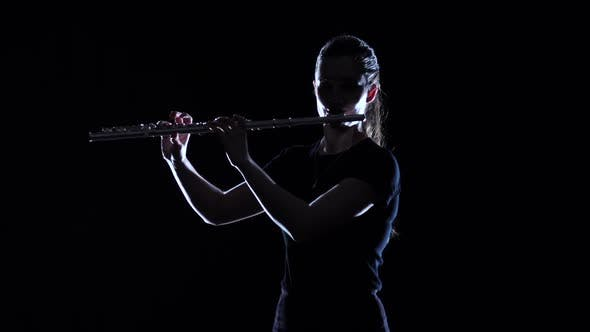 Thumbnail for Female Musician Blows Motif in Flute in Slow Motion. Studio