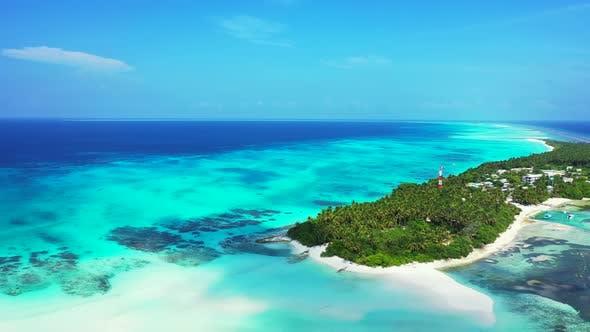 Thumbnail for Luxury birds eye tourism shot of a sunshine white sandy paradise beach and aqua blue ocean backgroun