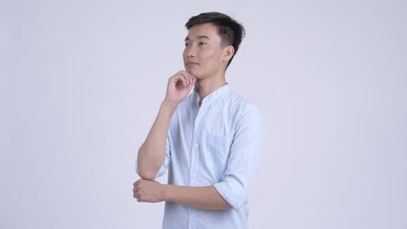 Young Asian Businessman Thinking with Various Emotions