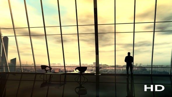Thumbnail for Бизнесмен перед панорамным офисным окном HD