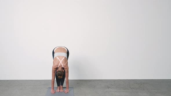 Thumbnail for Woman Performing Yoga Against Wall