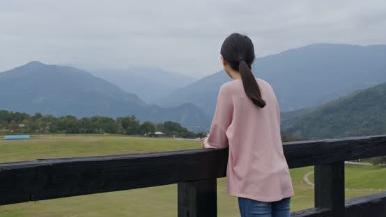 Cover Image for Woman enjoy the view in countryside