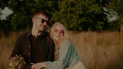 Affectionate Happy Loving Stylish Couple Walking and Embracing