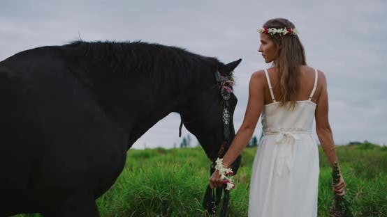 Thumbnail for Beautiful woman walking with horse