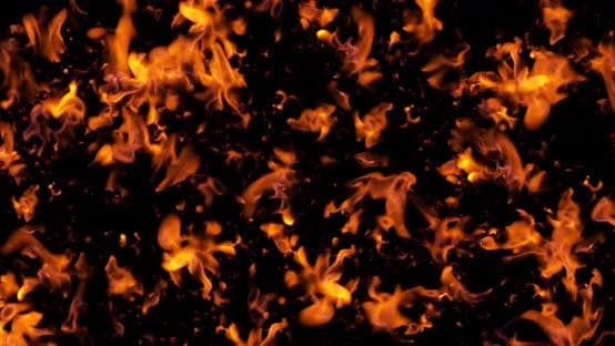 Coal in the grill isolated on black background. View from Top. Inferno firewall with seamless loop