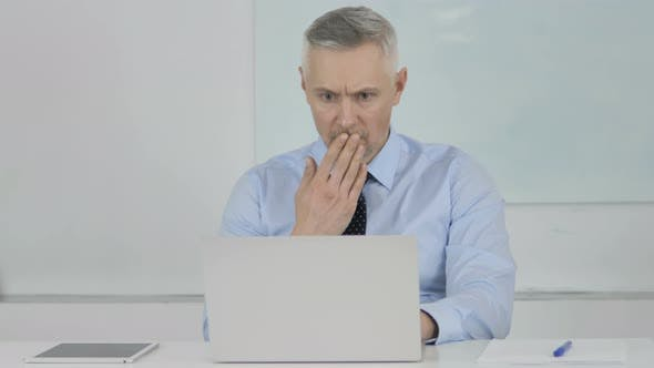 Senior Businessman in Shock Reacting To Result of Project