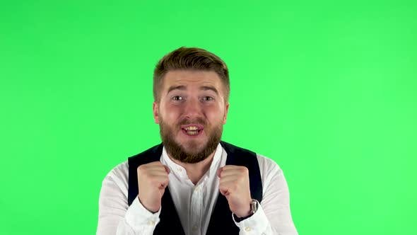 Thumbnail for Man Looking at the Camera with Excitement, Then Celebrating His Victory Triumph on Green Screen
