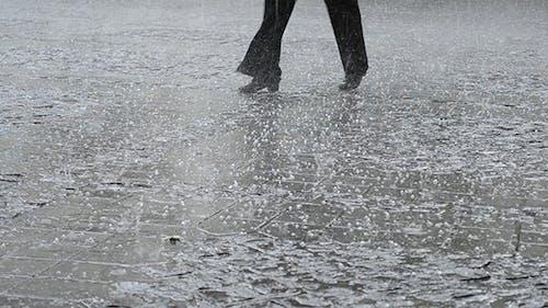 Man Walks Through The Hail Rain