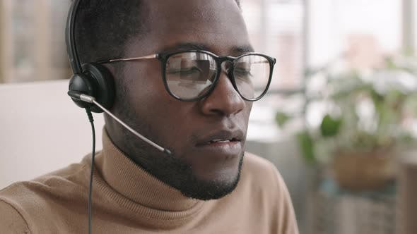 African Male Operator Working in Call Center