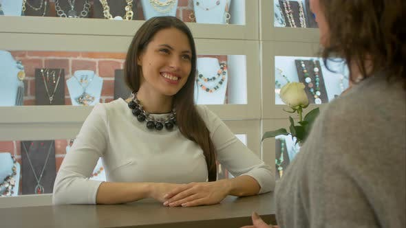 Thumbnail for Young Female Seller Meets and Listens To Buyer Who Just Comes To Jewelry Shop