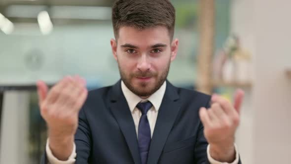Thumbnail for Assertive Young Businessman with Pointing and Inviting