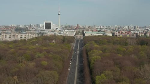 AERIAL: Strasse des 17. Juni with View on Brandenburg Gate in Berlin, Germany on Sunny Day