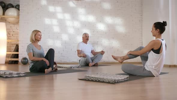 Cover Image for Caucasian Husband and Wife Having Private Yoga Class in Studio