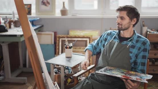 Bearded Male Artist Painting in Studio