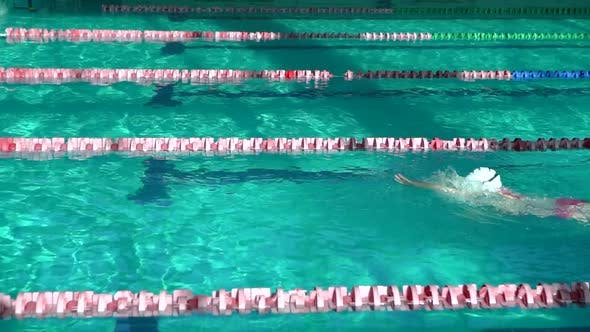 Thumbnail for Amator Swimmer Practicing in Water Swimming Pool