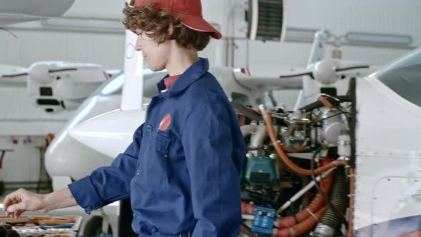 Thumbnail for Woman Fixing Airplane Engine