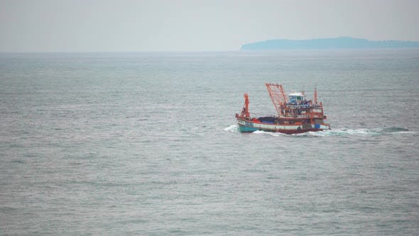 A cargo boat transports goods by sea. Ship float on the waves
