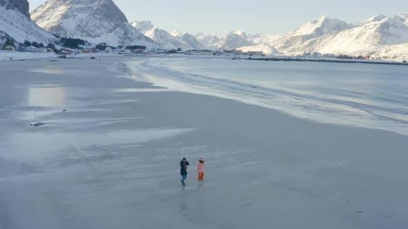 Thumbnail for Children On A Winter Polar Beach 2