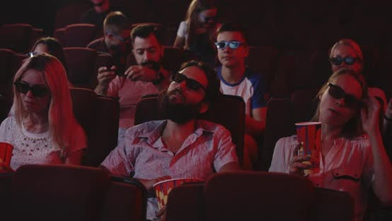 Thumbnail for Man Sleeping Through a Movie in a Cinema