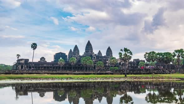 Daytime time lapse at Angkor Wat main facade reflection on water pond, Cambodia
