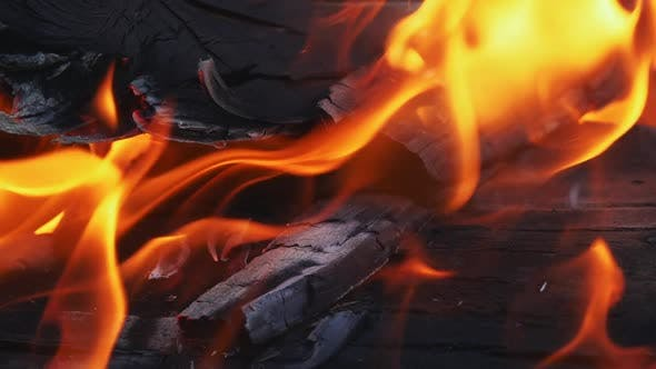 Thumbnail for Close Up of Pile of Wood Burning with Flames