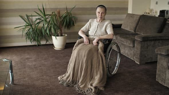Thumbnail for Grandmother on a Wheelchair in the Room