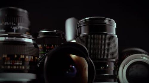 Macro Camera Lens Rotating Display On Black Background