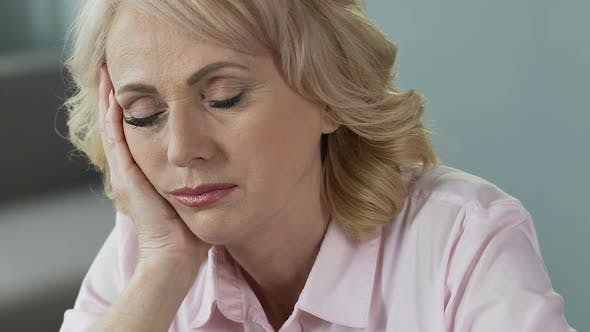 Thumbnail for Overworked Mature Woman Sleeping at Workplace, Lack of Sleep and Vitamins