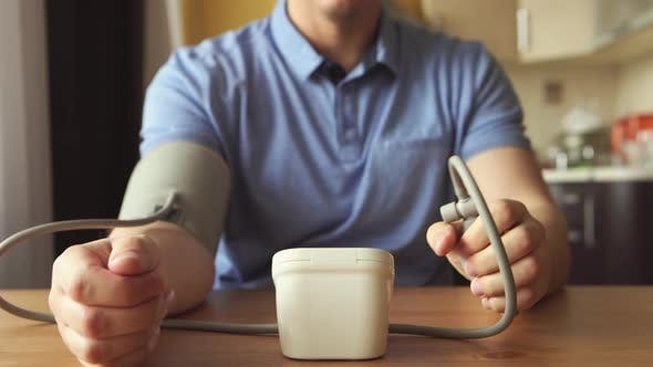 Thumbnail for Young man measuring the blood pressure at the room