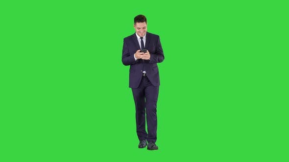 Thumbnail for Businessman on the Phone Typing Text Message Walking on a Green Screen, Chroma Key