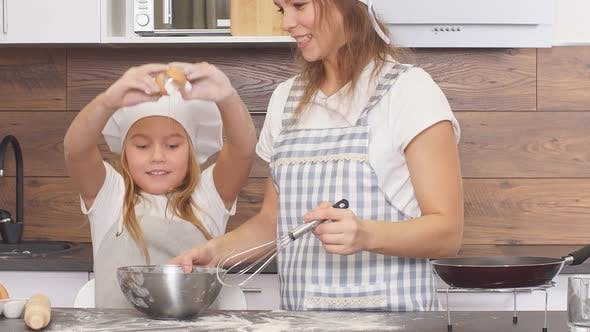 Thumbnail for Caucasian Woman and Child Girl Together in Kitchen