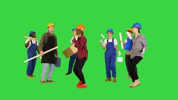 Group of Multiethnic Construction Workers Dancing on a Green Screen Chroma Key