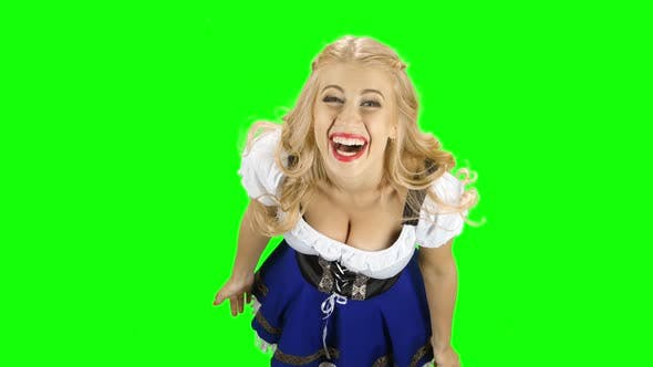 Thumbnail for Woman in Bavarian National Costume Laughs. Green Screen