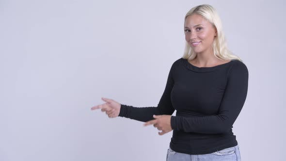 Thumbnail for Young Happy Blonde Woman Pointing Fingers and Showing Something