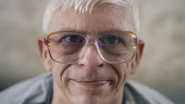 Portrait of Aged Man in Glasses