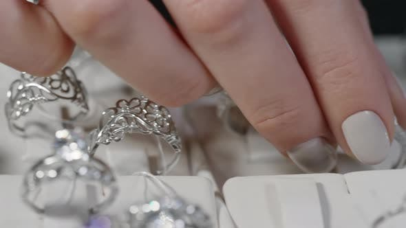 Thumbnail for Hands of Woman Choosing Silver Ring
