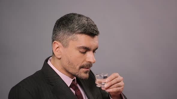 Thumbnail for Rich Man in Suit Sitting in Restaurant and Drinking Vodka, Alcoholic Addiction