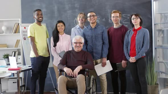 Cover Image for Portrait of Disabled Professor and Group of Students