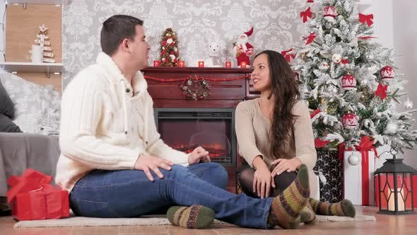 Thumbnail for Couple Giving Each Other Presents in Christmas Eve