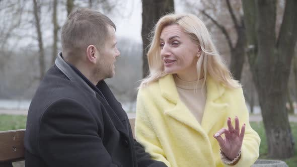 Charming Blond Caucasian Woman Talking Emotionally with Adult Man and Smiling. Portrait of Loving