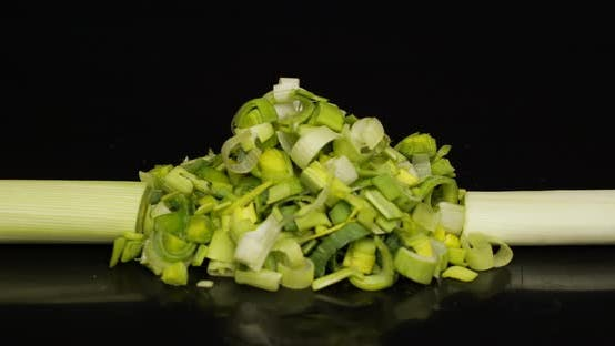 Thumbnail for Cutting Leek Onion on Black Background