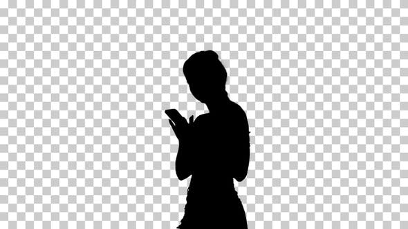 Thumbnail for Silhouette Cute girl checking her cell phone and dancing
