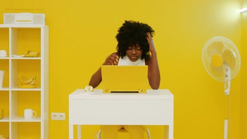 Stylish African Woman Is Using Laptop