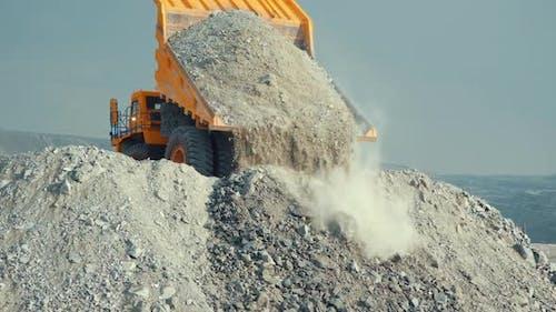 Mining Loader Unloads Limestone Ore Or Rock