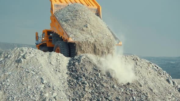 Cover Image for Mining Loader Unloads Limestone Ore Or Rock
