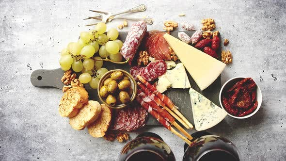 Thumbnail for Cold Snacks Board with Meats, Grapes, Wine, Various Kinds of Cheese