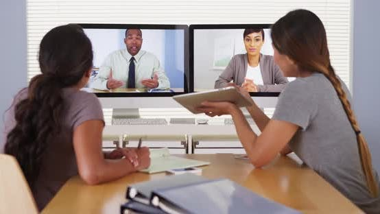Thumbnail for Diverse business colleagues holding a video conference meeting