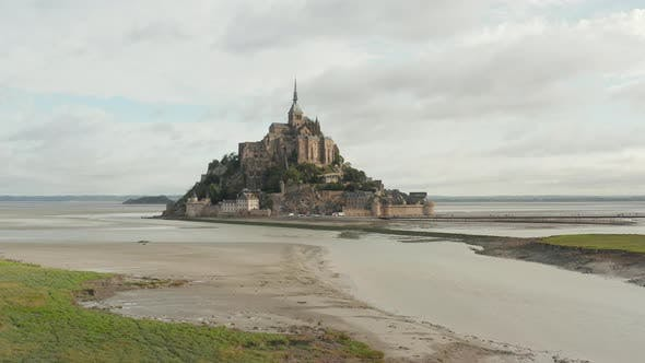 Thumbnail for Beautiful Mont Saint Michel in French Normandy, Aerial Establisher Forward