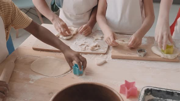 Thumbnail for Children Shaping Cookies with Cutters