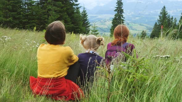Thumbnail for Mother With Daughters Looking A The Mountains Panorama